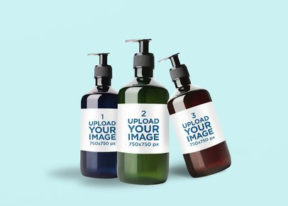 Mockup Featuring Three Hand Sanitizer Bottles Against a Solid Color Background 3986-el1