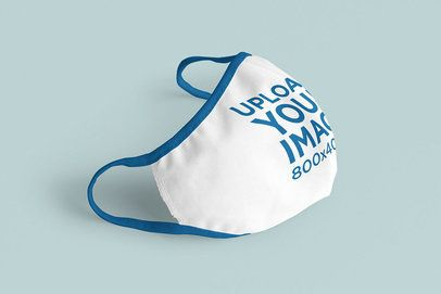 Mockup Featuring a Customizable Face Mask Against a Solid Color Background 3978-el1
