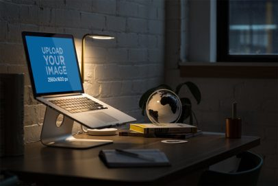 MacBook Mockup Featuring a Desk with Dim Light 3830-el1
