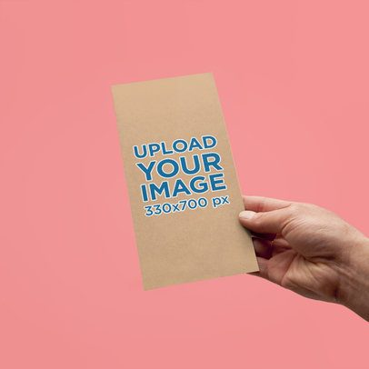 Mockup Featuring a Hand Holding a Vertical Bifold Brochure Against a Plain Background 4184-el1