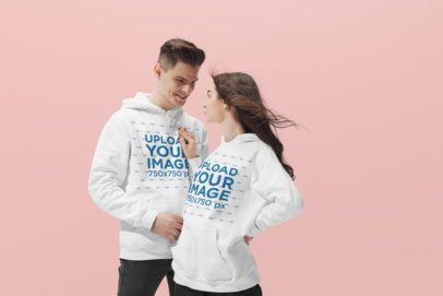 Mockup of a Cool Young Couple Wearing Pullover Hoodies at a Studio 34592-r-el2