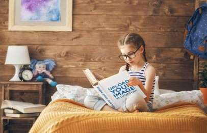 Mockup of a Little Girl Reading a Book in Bed 34668-r-el2