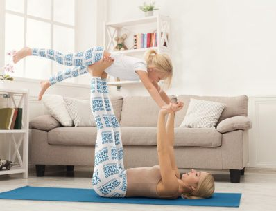 Mockup of a Mother and Her Daughter Sharing a Yoga Mat in Matching Leggings 34534-r-el2