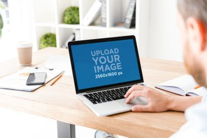 MacBook Mockup of a Man Working on His Desk 36934-r-el2