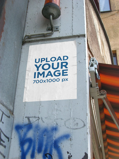 Mockup of a Poster Glued to a Wall with Graffiti 4514-el1
