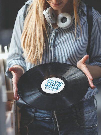 Mockup of a Woman Holding a Vinyl Record 36719-r-el2