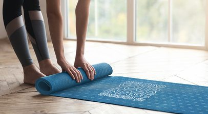 Mockup of a Woman Rolling Up a Yoga Mat 37072-r-el2