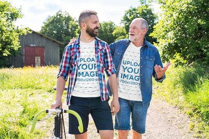 Mockup of a Son and Father Wearing Matching T-Shirts on a Sunny Day 37506-r-el2