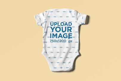 Baby Onesie Mockup Featuring the Back View of the Garment on a Solid Surface 4586-el1