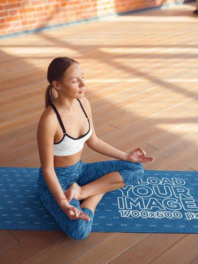 Mockup Featuring a Woman Meditating on a Yoga Mat 37112-r-el2