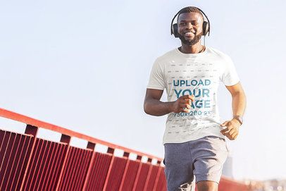 T-Shirt Mockup of a Bearded Man Running with Headphones 37945-r-el2