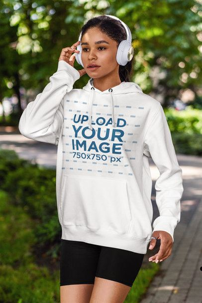 Hoodie Mockup of a Woman Listening to Music While Walking in the Park 4850-el1