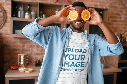 T-Shirt Mockup of a Man Playing with Two Orange Slices 38312-r-el2