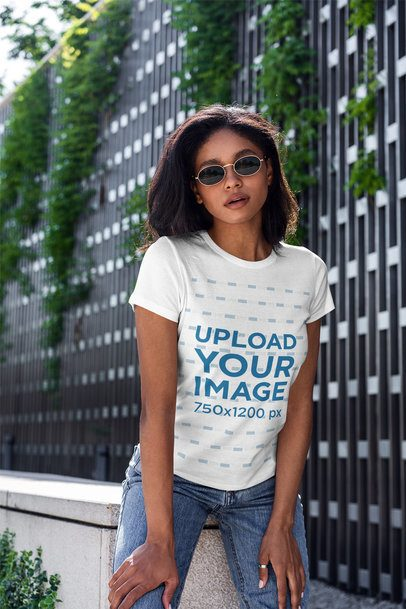 T-Shirt Mockup Featuring a Woman and Plants in the Background 4824-el1