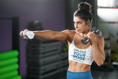 Sports Bra Mockup of a Serious Woman Training With a Pair of Dumbbells 38387-r-el2