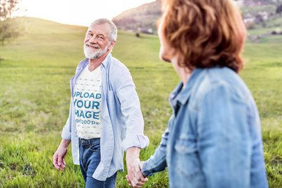 V-Neck T-Shirt Mockup of a Happy Senior Man Holding Hands with His Wife 39100-r-el2