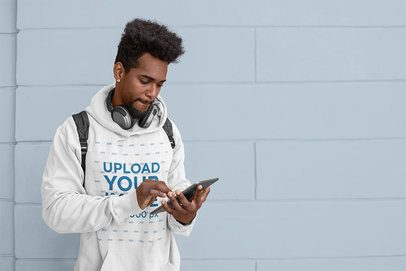 Hoodie Mockup of a Student Checking His Tablet 39168-r-el2