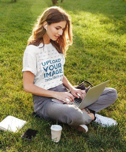 T-Shirt Mockup of a Young Woman Working at a Park 39180-r-el2