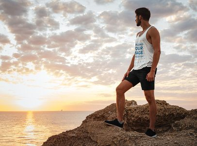 Tank Top Mockup of an Athletic Man Standing on a Rock at the Beach 34914-r-el2