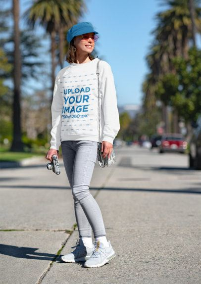Mockup of a Young Woman with a Sweatshirt and a Vintage Camera 36286-r-el2