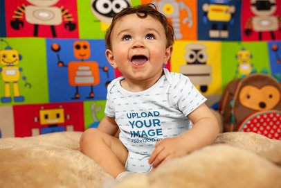 Mockup of a Joyful Baby Boy Smiling Wearing A Onesie 14027