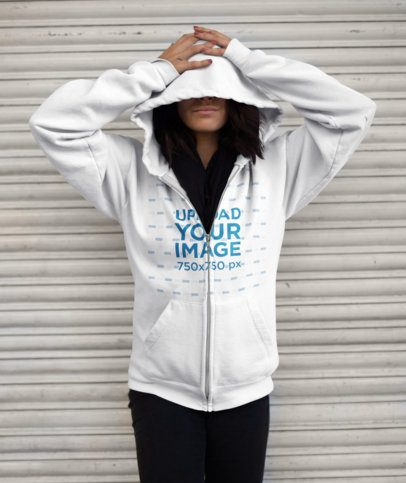 Full-Zip Hoodie Mockup of a Woman on the Street with her Face Covered 13178a
