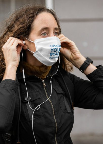 Face Mask Mockup of a Woman Listening to Music on the Street 41267-r-el2