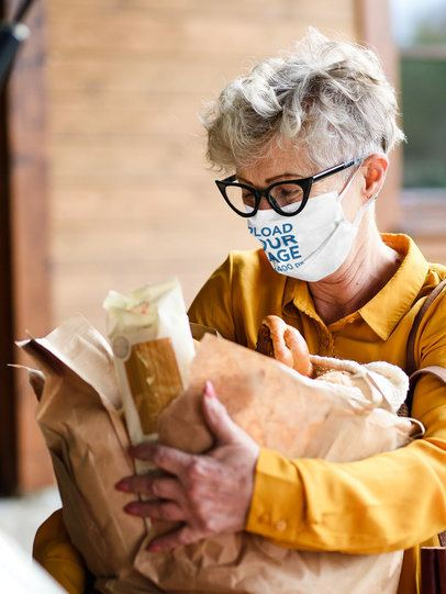 Mockup of a Senior Woman With a Face Mask Carrying Groceries 40555-r-el2
