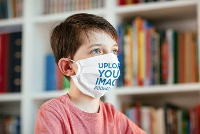 Face Mask Mockup Featuring a Boy Sitting Next to a Bookshelf 40524-r-el2