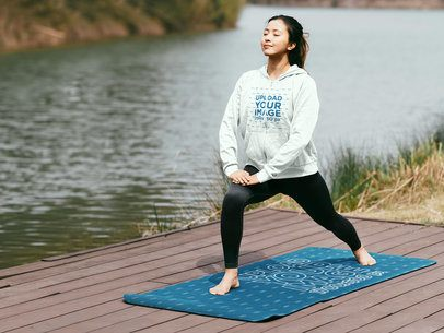 Full-Zip Hoodie Mockup Featuring a Woman by a Lake Practicing Yoga on a Mat 40818-r-el2