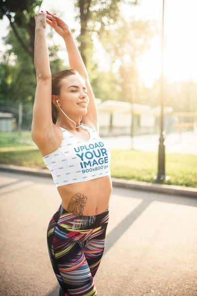 Mockup of a Tattooed Woman in a Sports Bra Stretching 34839-r-el2