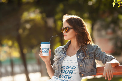 Mockup of a Trendy Woman Drinking from a Paper Cup While Wearing a V-Neck Tee 38055-r-el2