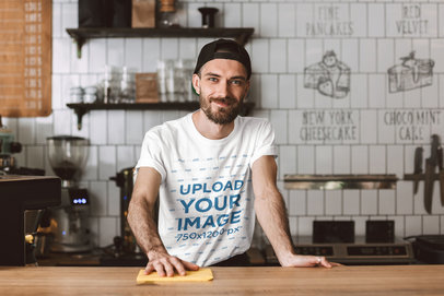 T-Shirt Mockup Featuring a Bearded Man Standing Behind a Cafe Counter 37573-r-el2