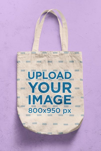 Mockup of a Tote Bag on a Colored Surface with a Rugged Texture 41710-r-el2