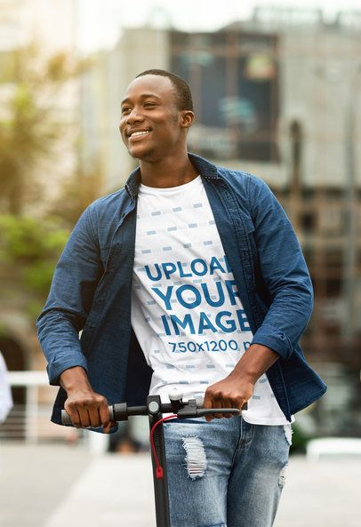 T-Shirt Mockup of a Smiling Man Riding a Scooter in the City 40171-r-el2