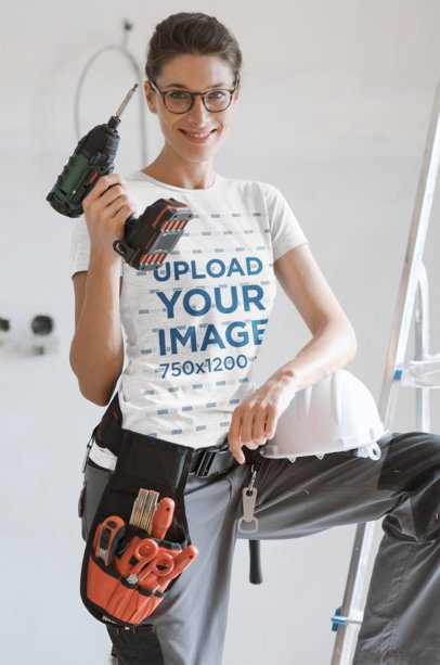 T-Shirt Mockup Featuring a Woman Holding a Drill 35222-r-el2