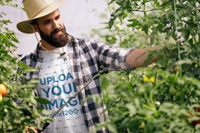 T-Shirt Mockup of a Bearded Farmer Fertilizing Some Tomato Plants 40163-r-el2