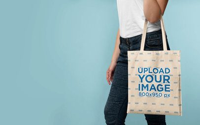 Mockup of a Woman Displaying a Tote Bag in a Studio 41542-r-el2