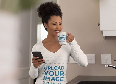 Mockup of a Woman with a V-Neck Long-Sleeve Tee Drinking from a Coffee Mug 40986-r-el2