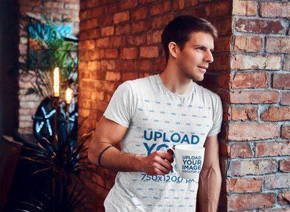 T-Shirt Mockup of a Muscular Man Holding a Coffee Mug 41454-r-el2