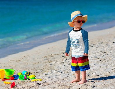 Raglan Long Sleeve Tee Mockup Featuring a Serious Kid With Sunglasses at the Beach 42129-r-el2
