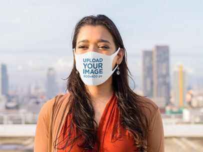Face Mask Mockup of a Long-Haired Woman Posing Against a City Skyline 41668-r-el2