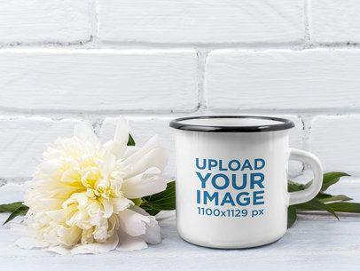 Mockup Featuring an Enamel Mug Placed by a Flower 40994-r-el2