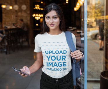 T-Shirt Mockup Featuring a Young Woman Holding Her Phone 41396-r-el2