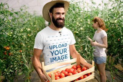 Mockup of a Man Wearing a Crew-Neck T-Shirt and Carrying a Tomato Box 40005-r-el2