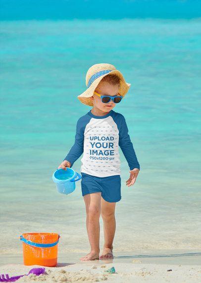 Raglan Long Sleeve Tee Mockup Featuring a Kid Playing at the Beach 42123-r-el2