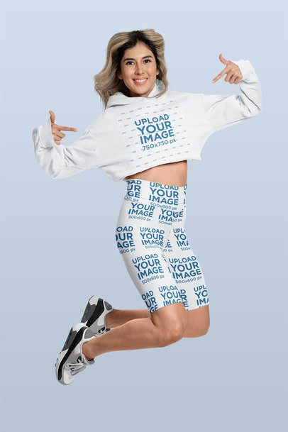 Bike Shorts Mockup of a Woman Pointing at Her Crop Top Hoodie 42363