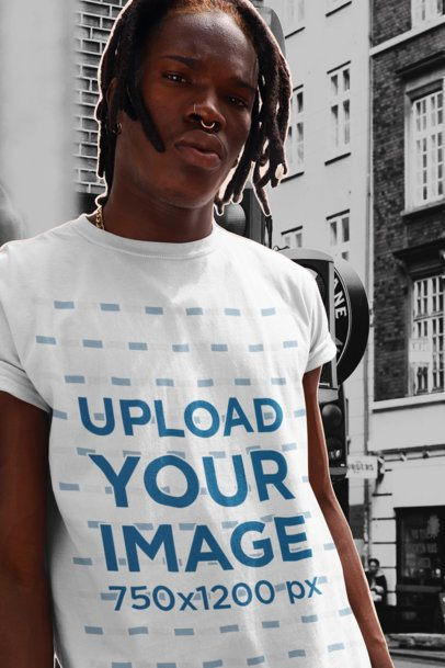 Collage-Style T-Shirt Mockup of a Man with a Nose Piercing Posing in the City 42549