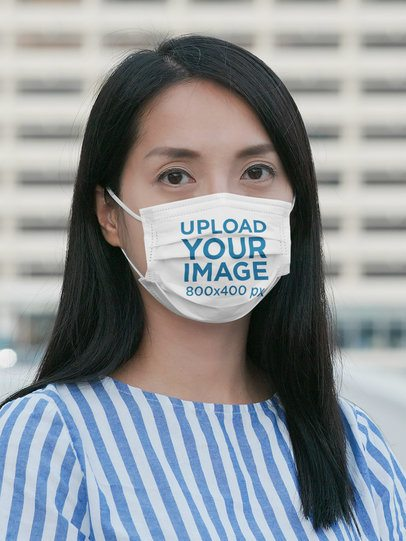 Face Mask Mockup Featuring a Long-Haired Woman in a City 42726-r-el2