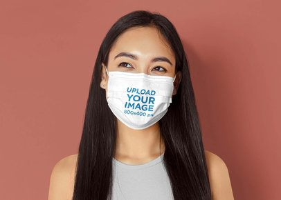 Face Mask Mockup Featuring a Long-Haired Woman in a Studio 42854-r-el2